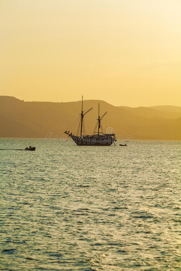 Ocean Sunset with Boat royalty free stock photography