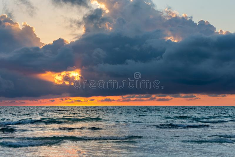 Ocean Sunset with Dramatic Dark Clouds royalty free stock photos