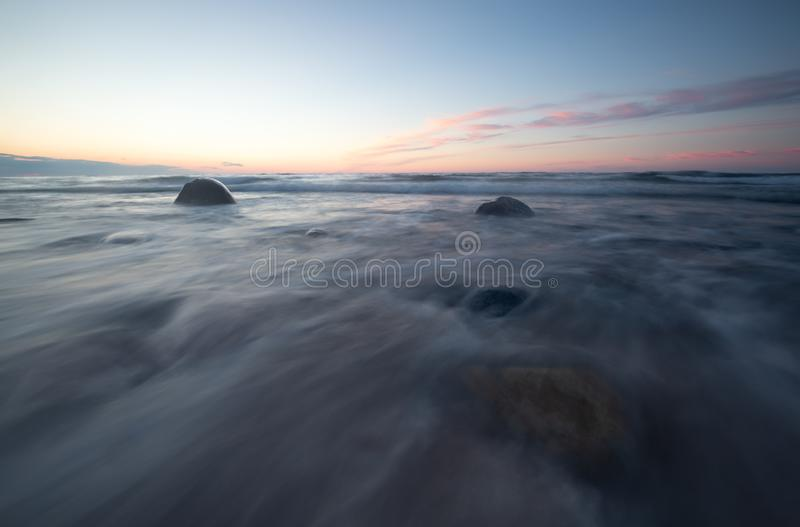 Ocean sunset photographed with long exposure stock photo