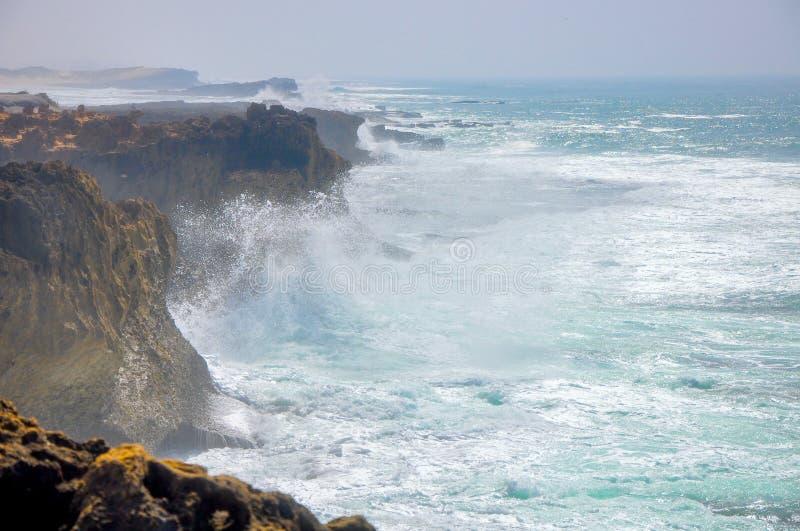 Huge waves crash against the rocky coast of the Atlantic Ocean stock image