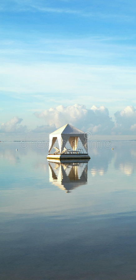 Ocean Tent with Lounge Chairs. White Tent with Lounge Chairs floating on the Calm Ocean, Bali, Indonesia stock photography