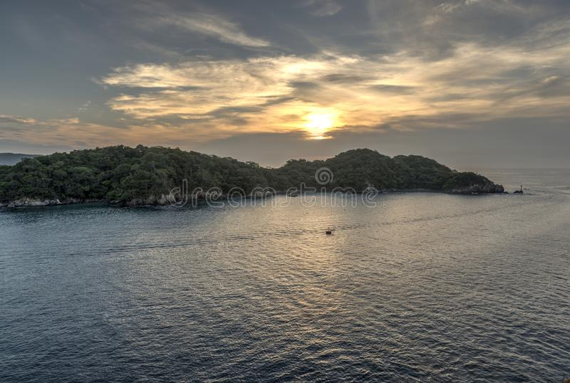 Sunrise in Huatulco Mexico. Sunrise in Huatulco. Huatulco is a resort region in the Mexican state of Oaxaca with white Pacific coast beaches. The region is made royalty free stock photography