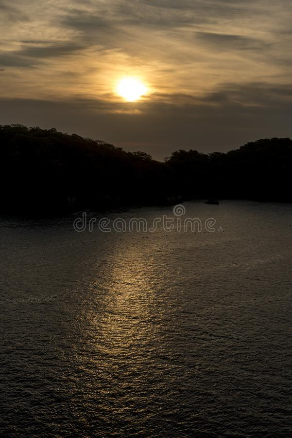 Sunrise in Huatulco Mexico. Sunrise in Huatulco. Huatulco is a resort region in the Mexican state of Oaxaca with white Pacific coast beaches. The region is made stock image