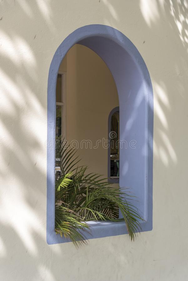 Arched open window in the shopping mall Santa Cruz Huatulco. Huatulco is a resort region in the Mexican state of Oaxaca with white Pacific coast beaches. The stock image