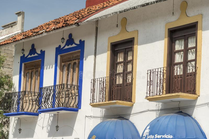 Windows and balconies above the shopping mall Santa Cruz Huatulco. Huatulco is a resort region in the Mexican state of Oaxaca with white Pacific coast beaches royalty free stock photography