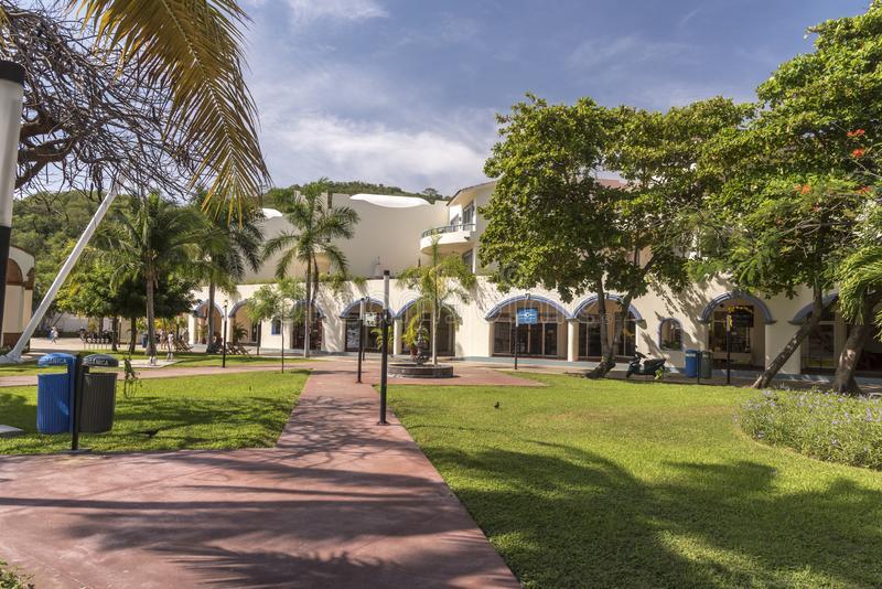 Park and shops in Santa Cruz Huatulco Mexico. Huatulco is a resort region in the Mexican state of Oaxaca with white Pacific coast beaches. The region is made stock photo