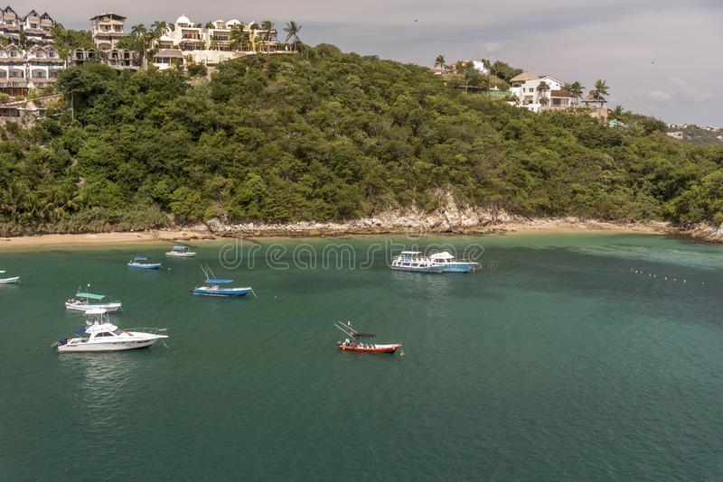 Buildings and boats in Santa Cruz Huatulco Mexico. Huatulco is a resort region in the Mexican state of Oaxaca with white Pacific coast beaches. The region is royalty free stock photography
