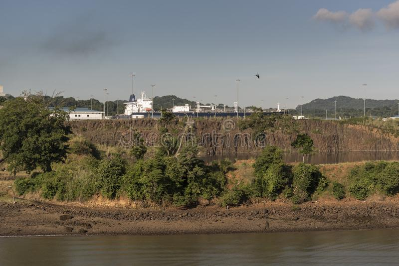 Hovden Spirit transiting the new Cocolí Locks Panama Canal expansion. From Island Princess in the old canal locks. The Panama Canal is an artificial 82 km 51 stock photography