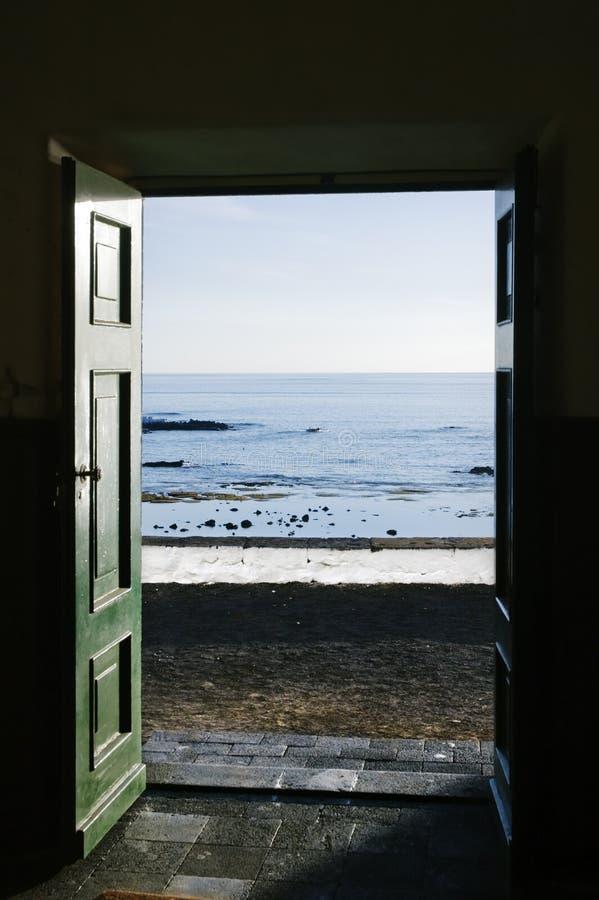 Ocean trough the door stock photo