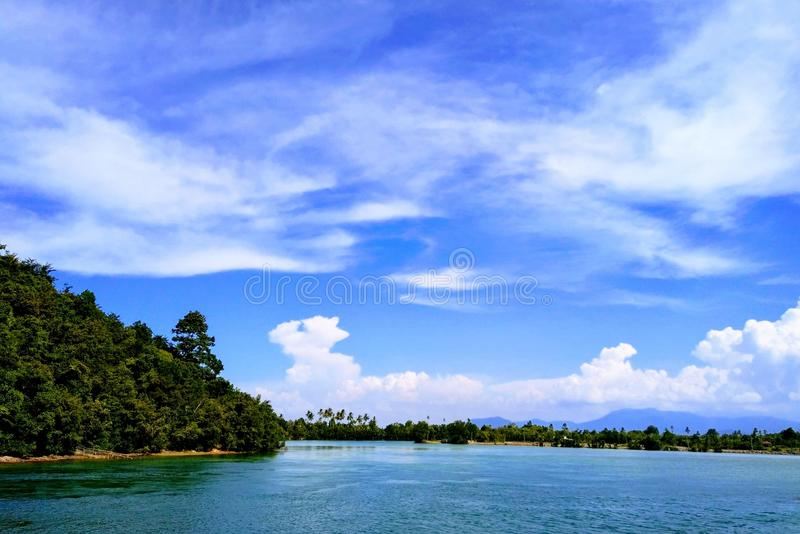 Ocean Under Blue Sky and White Clouds stock photography