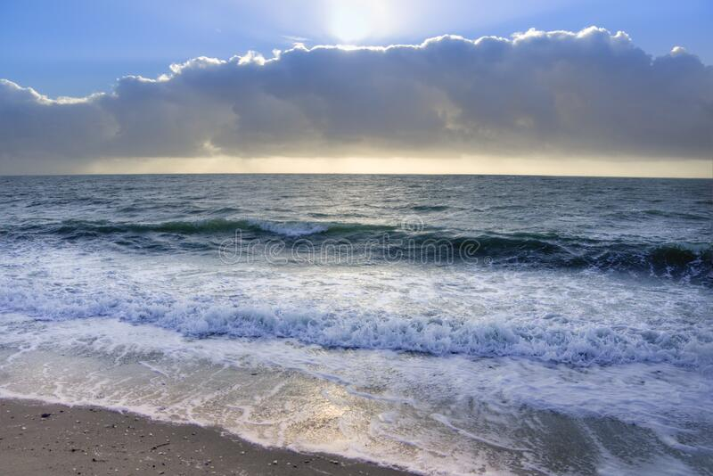 Ocean Under Blue Sky and White Clouds royalty free stock images