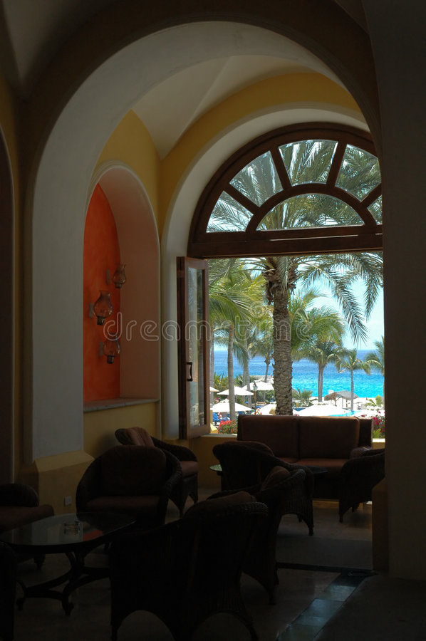 Ocean view through arched window in Cabo San Lucas, Mexico. View of beach and blue ocean through an arched window in Cabo San Lucas, Mexico royalty free stock photo