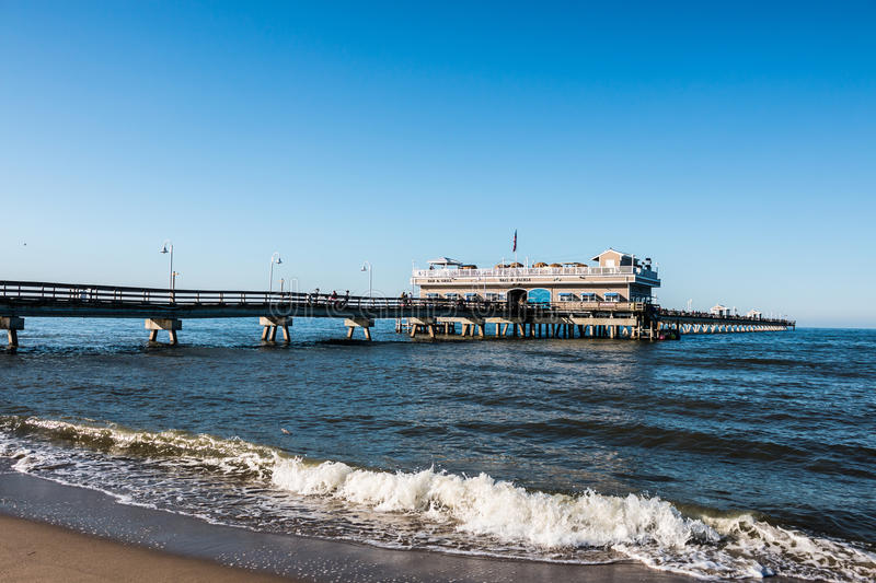 Ocean View Beach in Springtime with People on Pier stock image