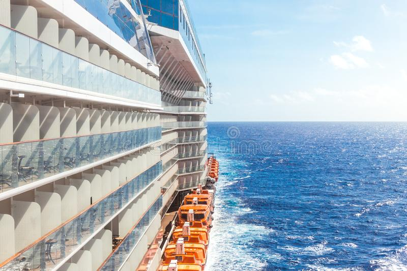 Ocean view from a cruise ship deck on a bright day. With blue skies and clouds in the Pacific ocean stock images