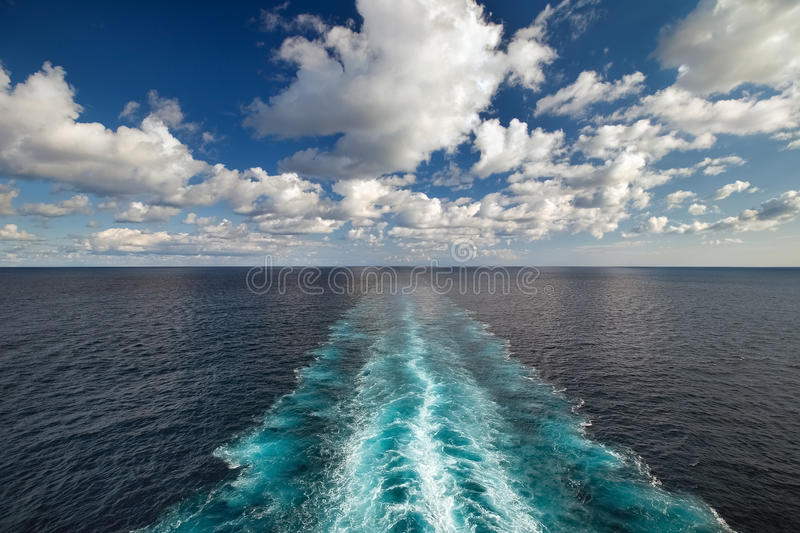 Ocean view from the deck of ship with wake trace. Ocean view from the deck of a ship with wake trace stock photo