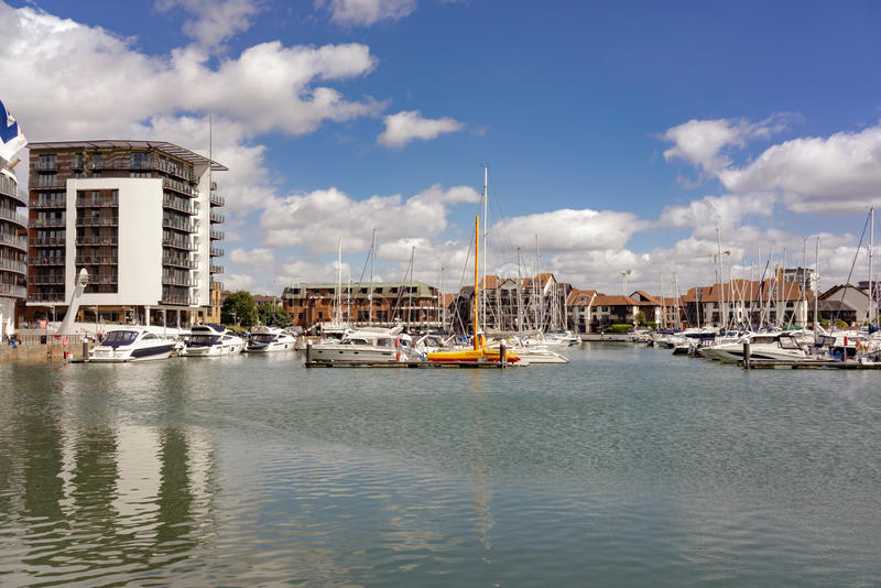 Ocean Village Marina in Southampton. The mixed use commercial and residential development of Ocean Village in Southampton on a warm summer's day stock photography