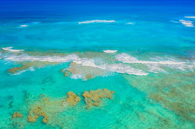 Ocean water surface aerial drone view in Dominican Republic. Vacation background royalty free stock image