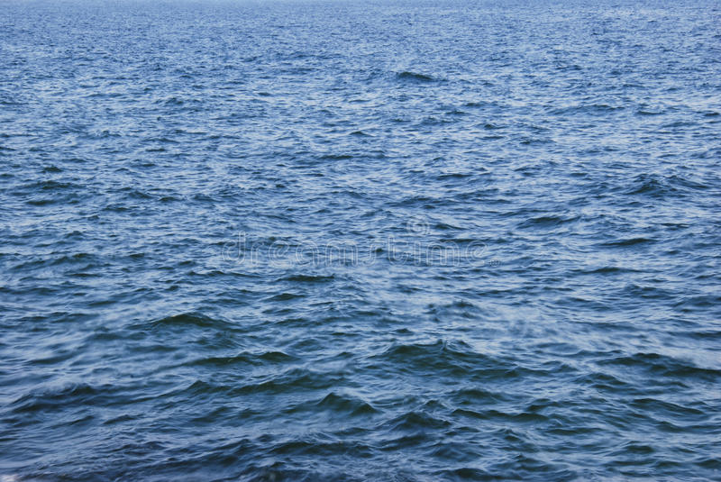 Ocean water texture. Blue ocean water texture showing small waves stock photo
