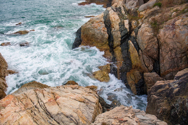 Ocean wave splash on the reef royalty free stock photo
