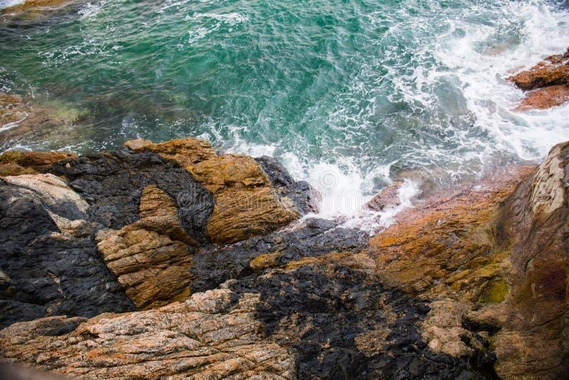 Ocean wave splash on the reef stock image
