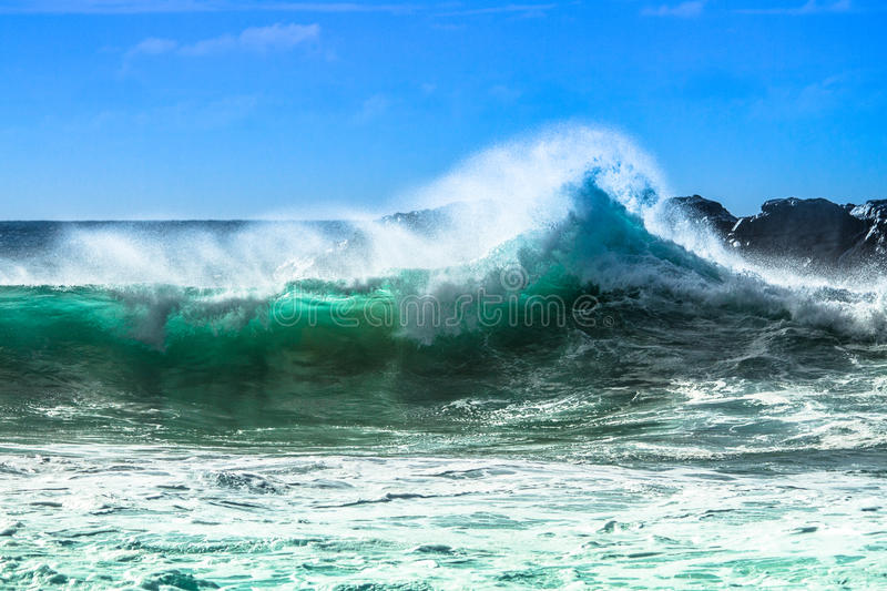 Ocean wave with spray stock photography