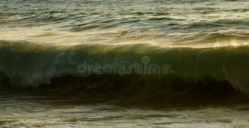 Ocean wave about to break stock photo