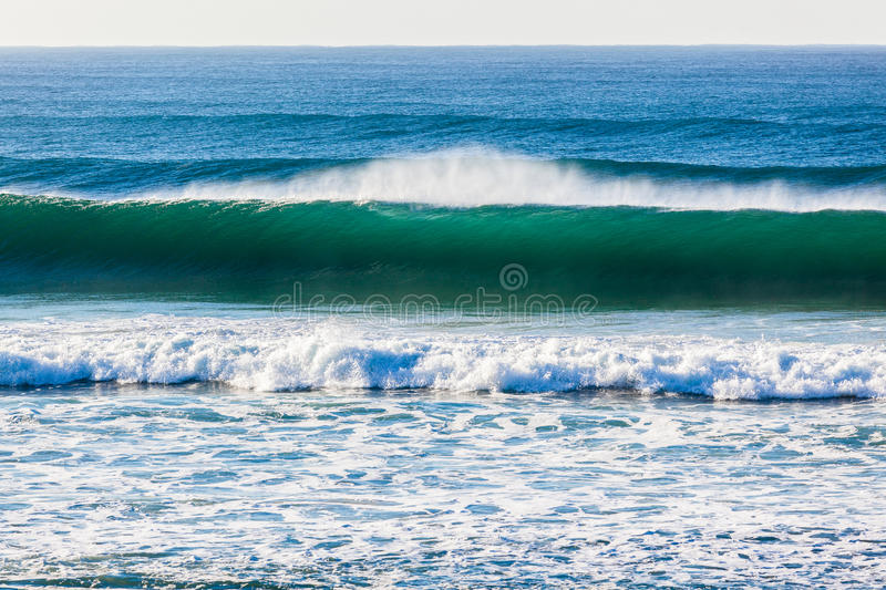 Ocean Wave Upright Wall. Clean colors of ocean wave upright vertical wall of sea water stock photography