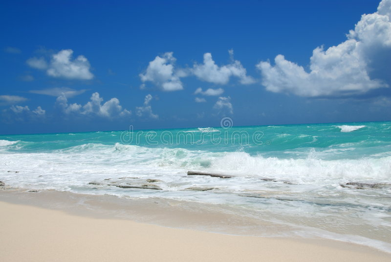 Ocean waves and beach scenery royalty free stock photo