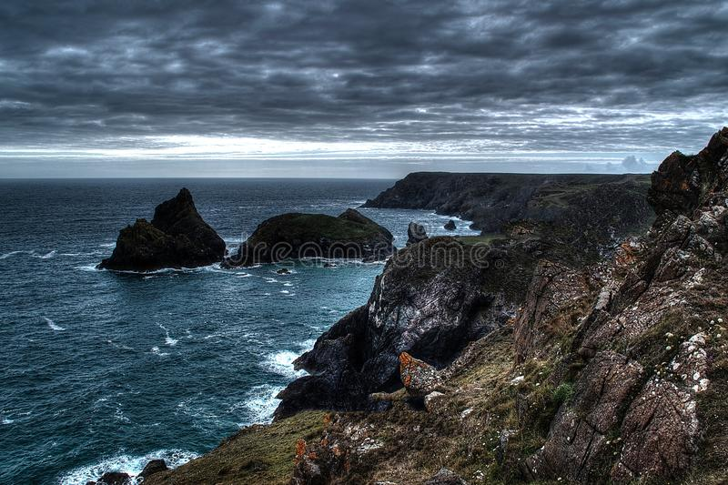 Ocean Waves Crashes Into Hill Cliff Under Grey Cloudy Sky Free Public Domain Cc0 Image