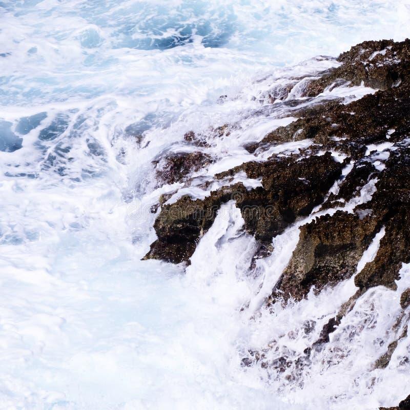 Ocean Waves Crashing on Rock Formation stock images