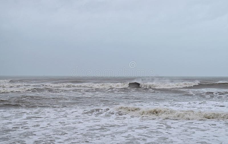 Ocean with Waves and High Tide with Cloudy Sky in Monsoon and Vayu Cyclone Storm - Seascape Background Wallpaper royalty free stock images