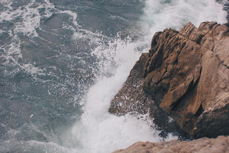 Ocean Waves Hitting an Outcrop stock images