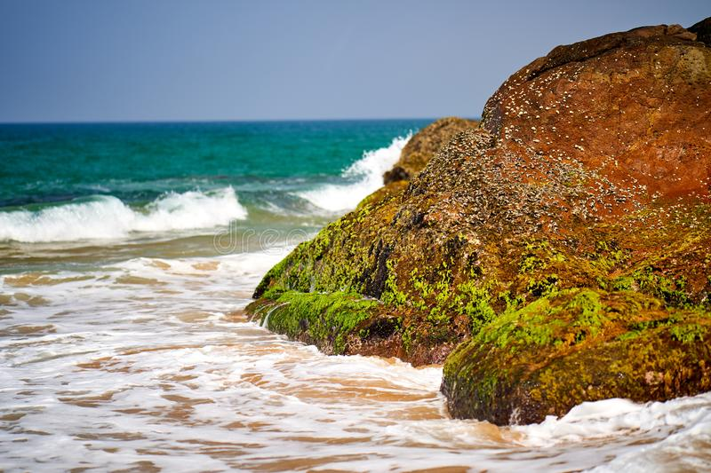 Ocean coast with big waves and rocks royalty free stock photography