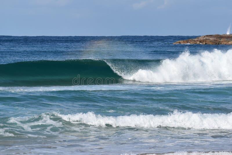 Ocean Waves with Rainbow Spray at Avoca Beach NSW Australia royalty free stock photo