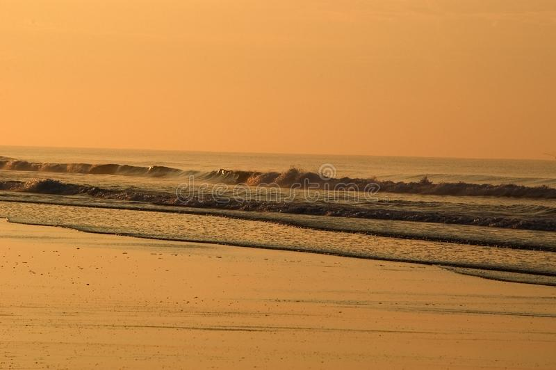 Ocean waves at sunrise