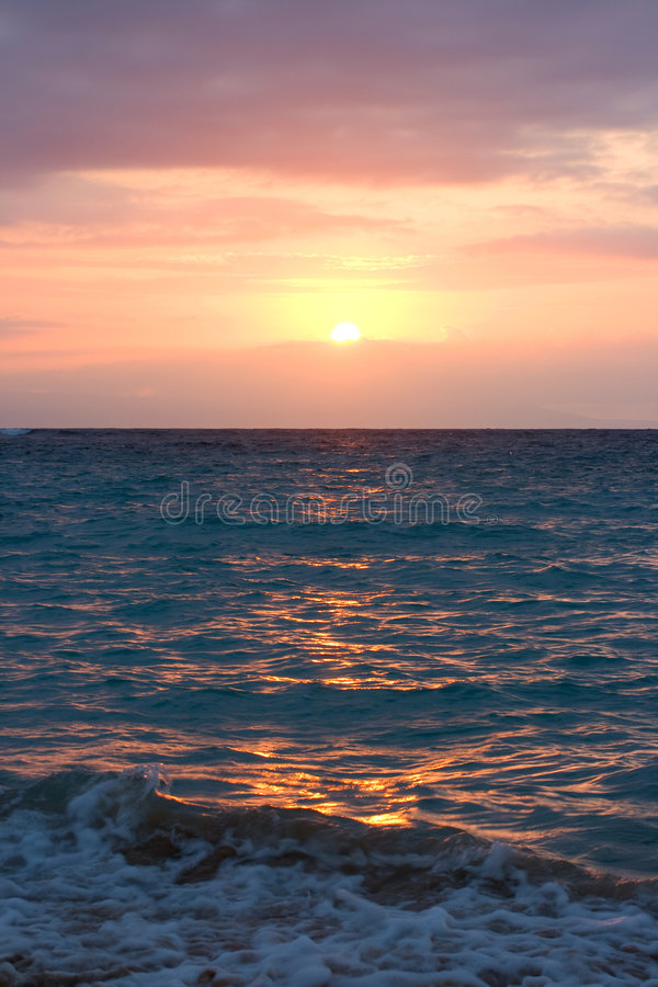 Ocean waves on sunrise royalty free stock photography