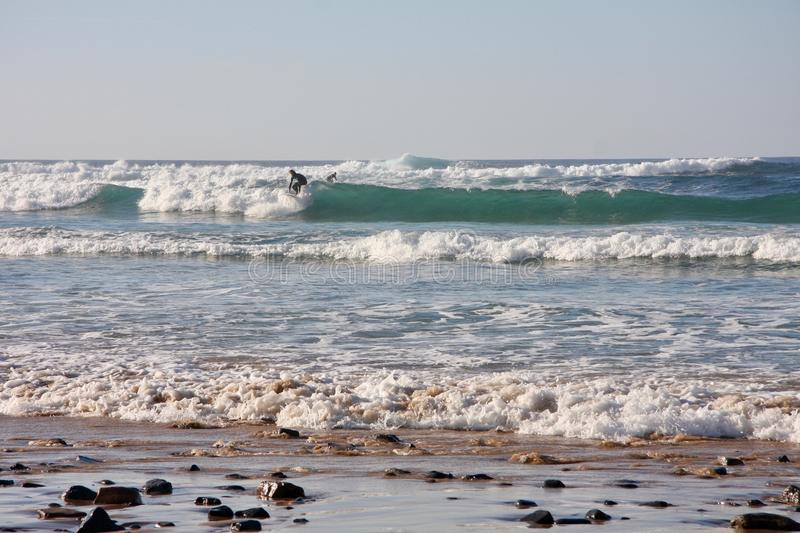 Ocean waves and surfer. stock photo