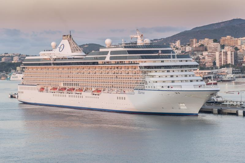 Oceania Cruises Cruise ship Marina in Palma at sunrise. From Queen Elizabeth. Palma is a resort city and capital of the Spanish island of Mallorca Majorca, in stock image