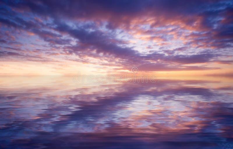 Oceano abstrato e por do sol imagem de stock