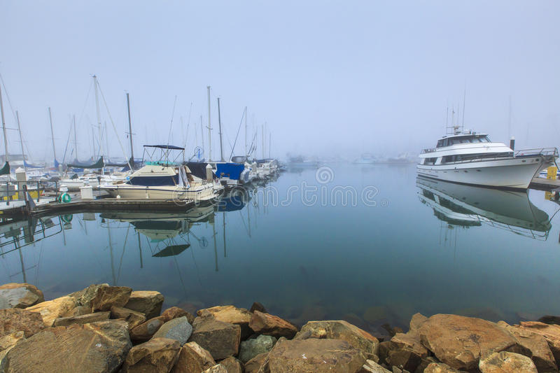 Oceanside California Foggy Harbor. This image of the Oceanside harbor was taken very early in the morning on a winter day when there was heavy fog. Oceanside is stock photos