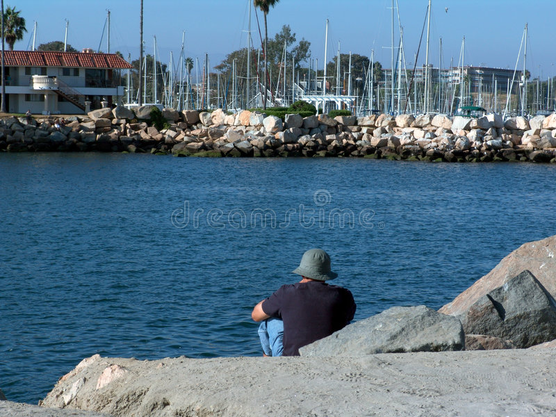 Oceanside Harbor. Tourist relaxing and taking in the view of the Oceanside harbor stock images
