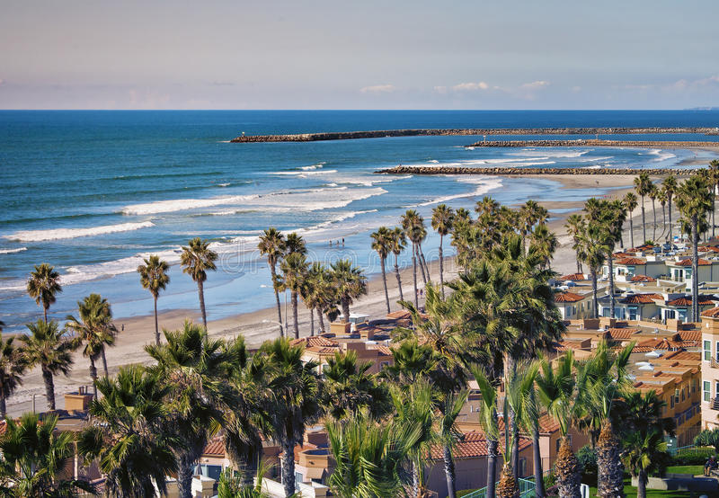 Oceanside Shoreline, California. A beach and homes along the shore of Oceanside, frequented by tourists as well as locals, in southern California near San Diego stock photo