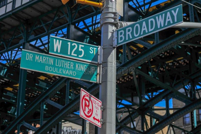 125. och Broadway gatatecken royaltyfri fotografi