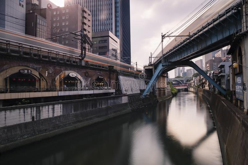 OCHANOMIZU, TOKYO - September 1, 2019 : View of the trains passing on the multiple tracks during the day. Long exposure landscape stock images