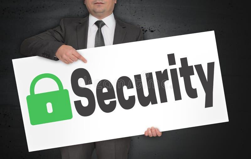 Ochrona plakat trzyma biznesmenem zdjęcia stock