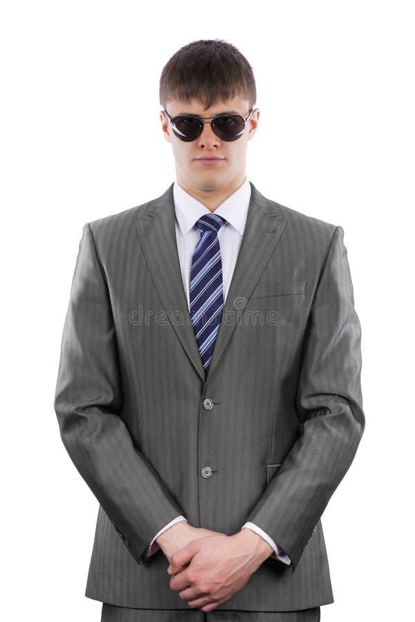 Ochroniarz jest ubranym sunglasse i kostium fotografia stock
