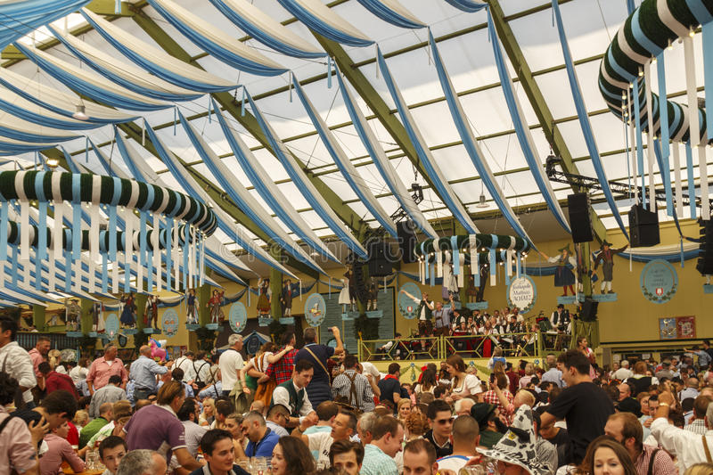 Ochsenbraterei tent at Oktoberfest in Munich, Germany, 2016. Munich, Germany - September 24, 2016: Inside the Ochsenbraterei beer tent at Oktoberfest with people royalty free stock photos