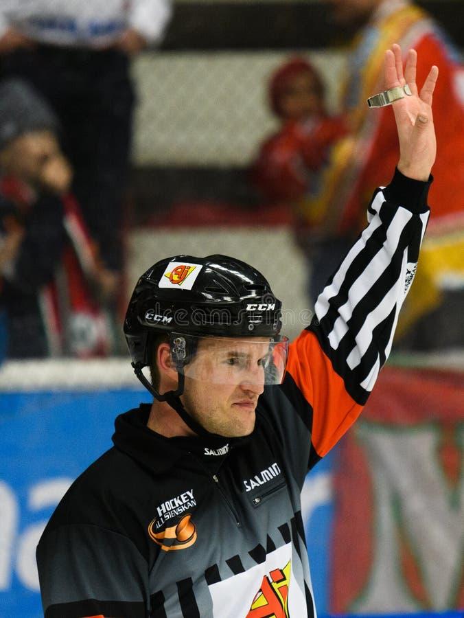 Hockey referee hold up his arm in the Ice hockey match in hockeyallsvenskan between SSK and MODO. Sodertalje, Sweden - January 15, 2017: Hockey referee hold up royalty free stock image