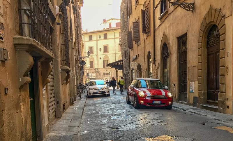 Red mini parked on a Florentine street, Italy stock photography