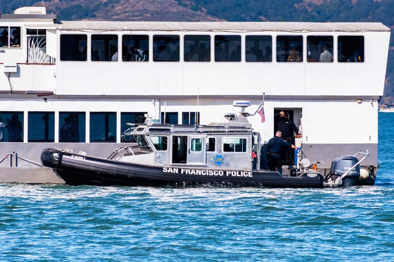 Oct 12, 2019 San Francisco / CA / USA - San Francisco Police Department vessel stopped next to a cruising ship; San Francisco stock images